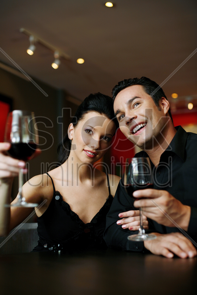 couple proposing a toast stock photo
