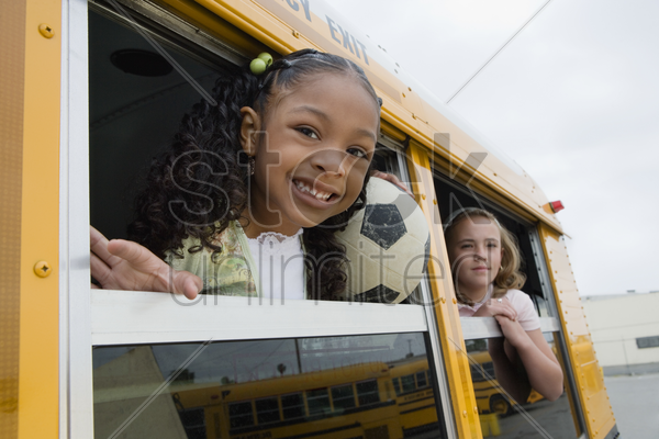 elementary students on school bus stock photo