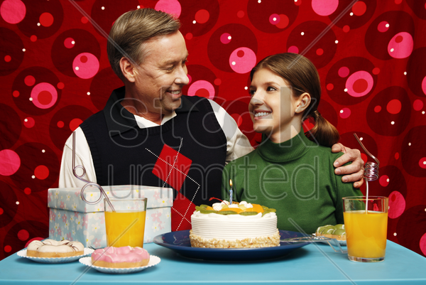 father and daughter celebrating birthday together stock photo
