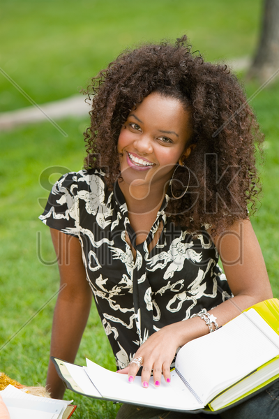 female student studying outdoors (portrait) stock photo