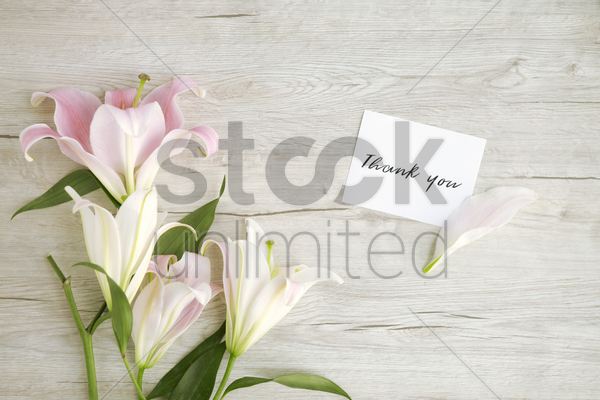 flatlay of wooden background with bouquet of flowers stock photo