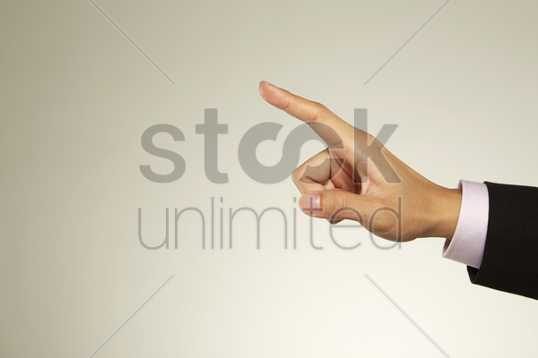 index finger pointing to the side stock photo