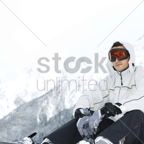 male snowboarder with ski goggles stock photo