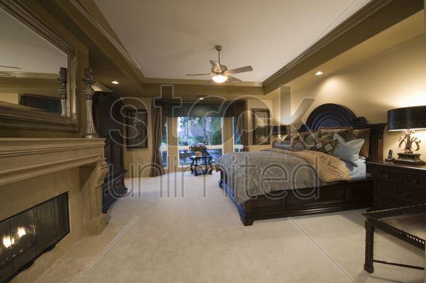 palm springs bedroom with dark wood furniture stock photo
