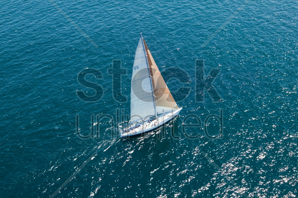 sailboat on ocean elevated view stock photo