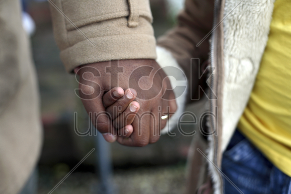 sisters holding hands stock photo