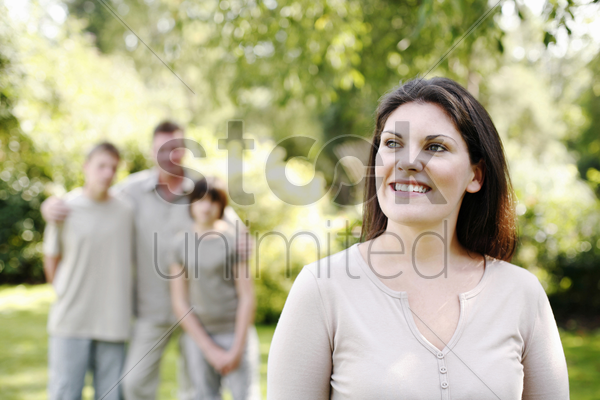 woman and her family spending the weekend in the park stock photo