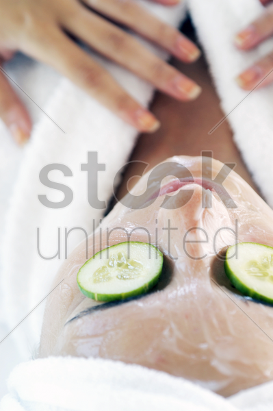 woman doing facial treatment stock photo