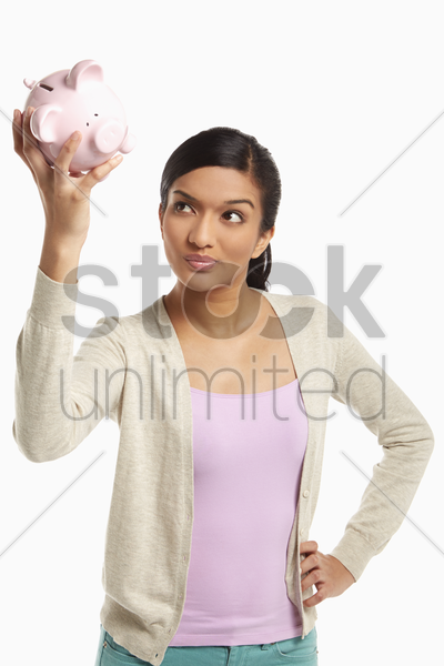 woman holding up a piggy bank stock photo
