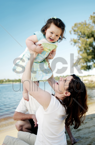 woman lifting up her daughter stock photo