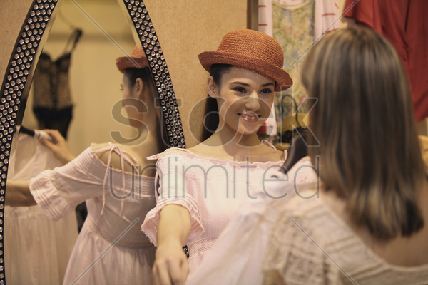 women shopping at clothes store stock photo