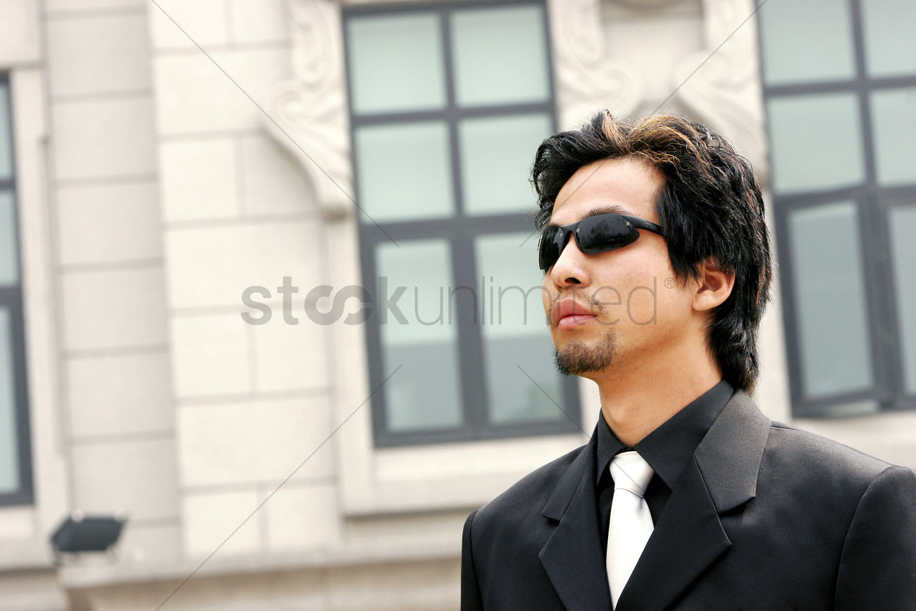 a-man-in-business-suit-wearing-sunglass_1677937.jpg