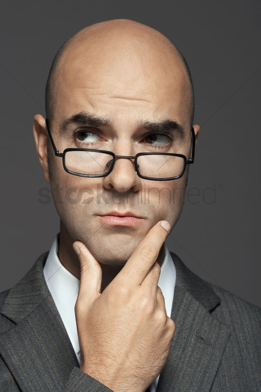 Bald Man Wearing Glasses With Hand On Chin Stock Photo 1891677
