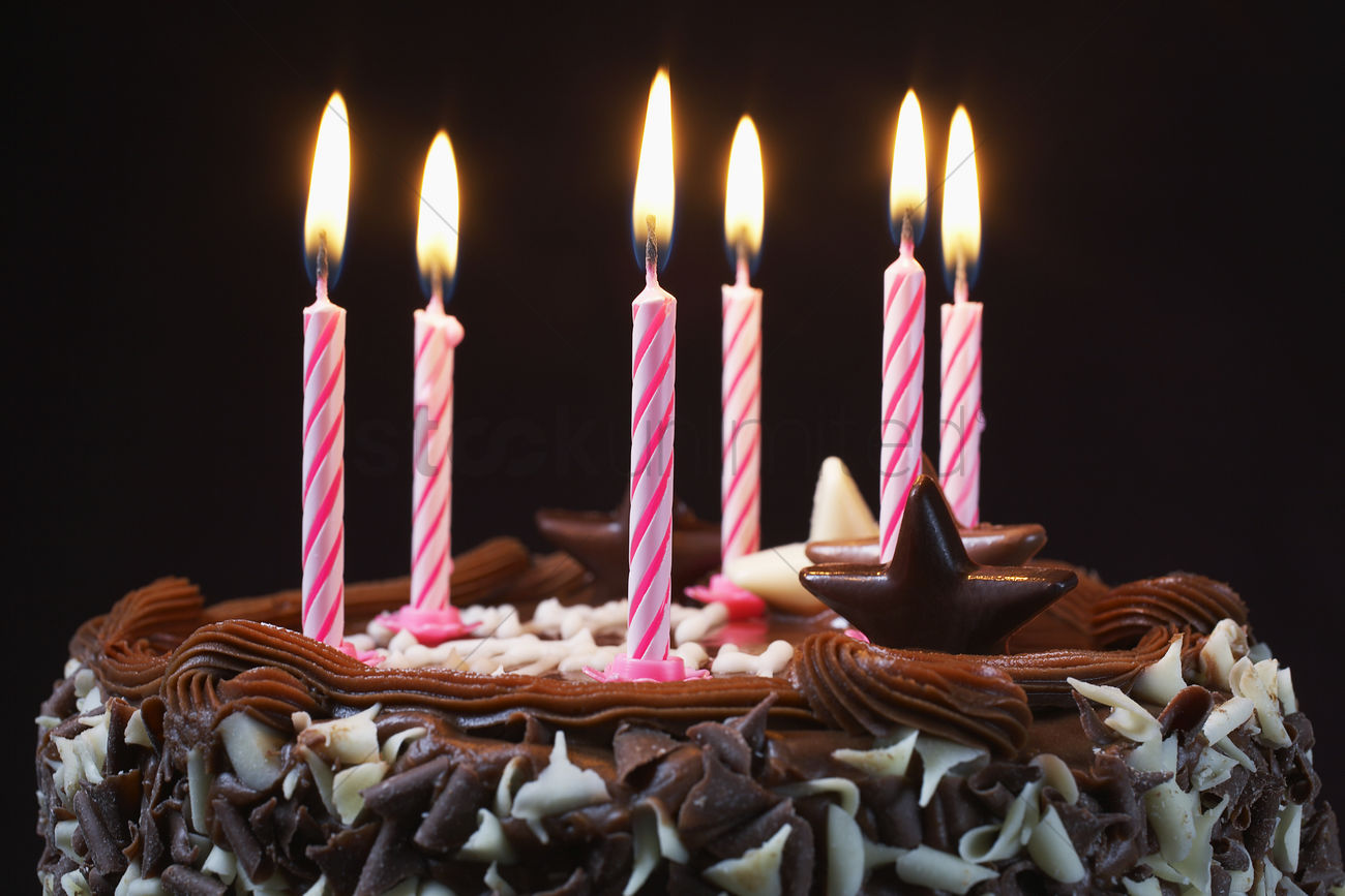 birthday cake with lit candles close up stock photo 1903949