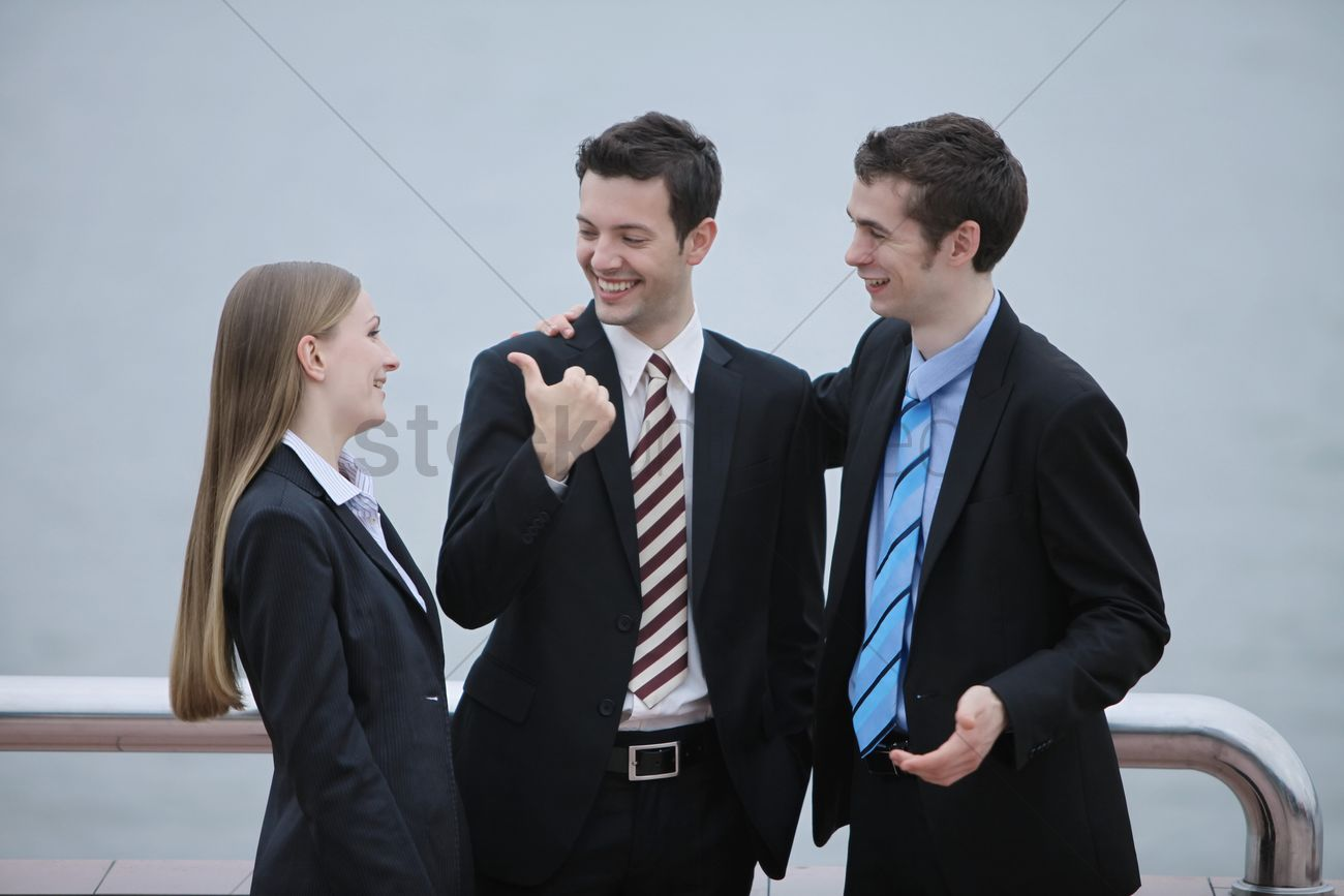business people talking to each other outdoors stock photo 1857929