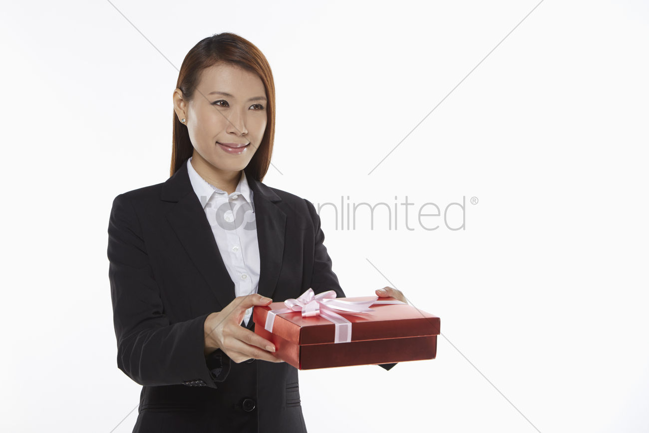 businesswoman handing out a gift box stock photo 1836161