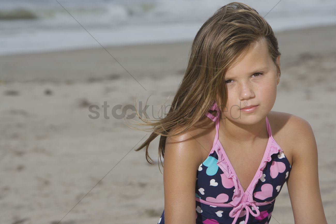 Little Girl Sitting On A Beach Stock Photo - 1908861  Stockunlimited-2536