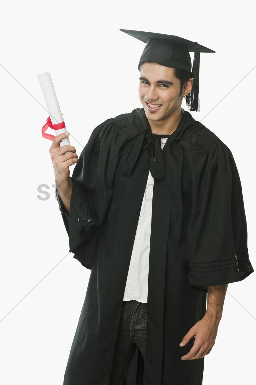 Man in a graduation gown holding a diploma Stock Photo - 2057129 ...