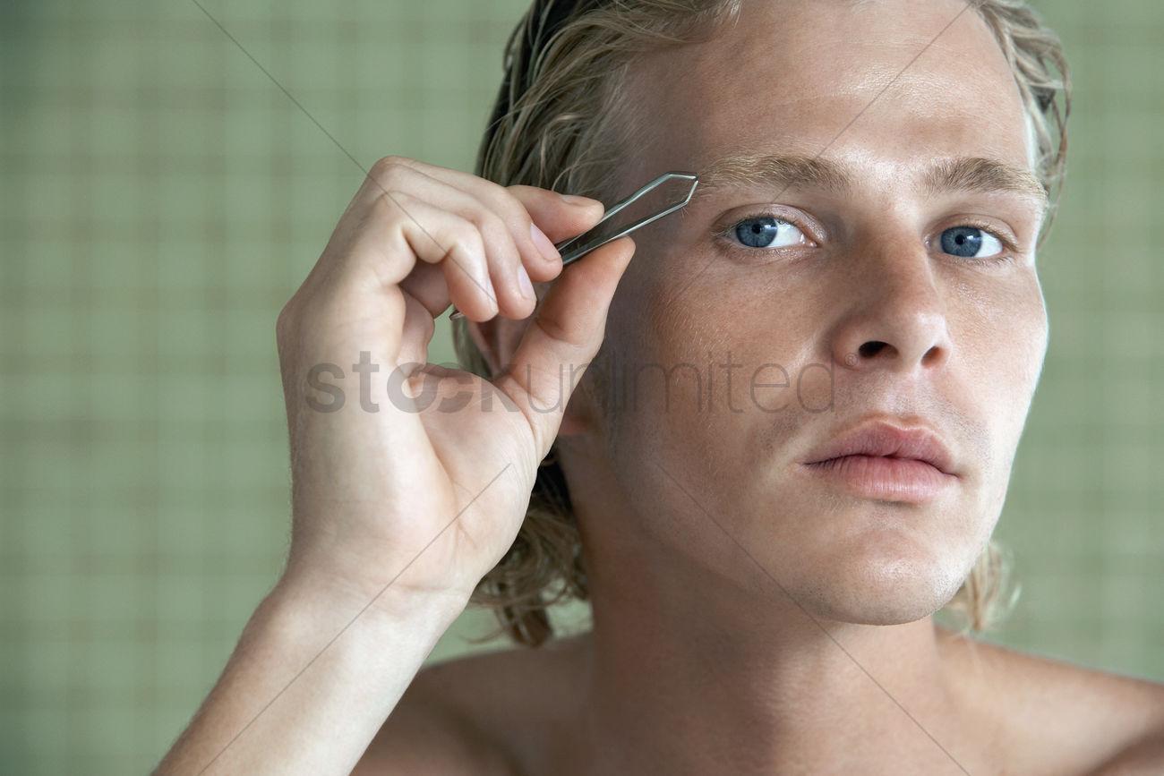 Man Plucking Eyebrows Close Up Stock Photo 1894145 Stockunlimited