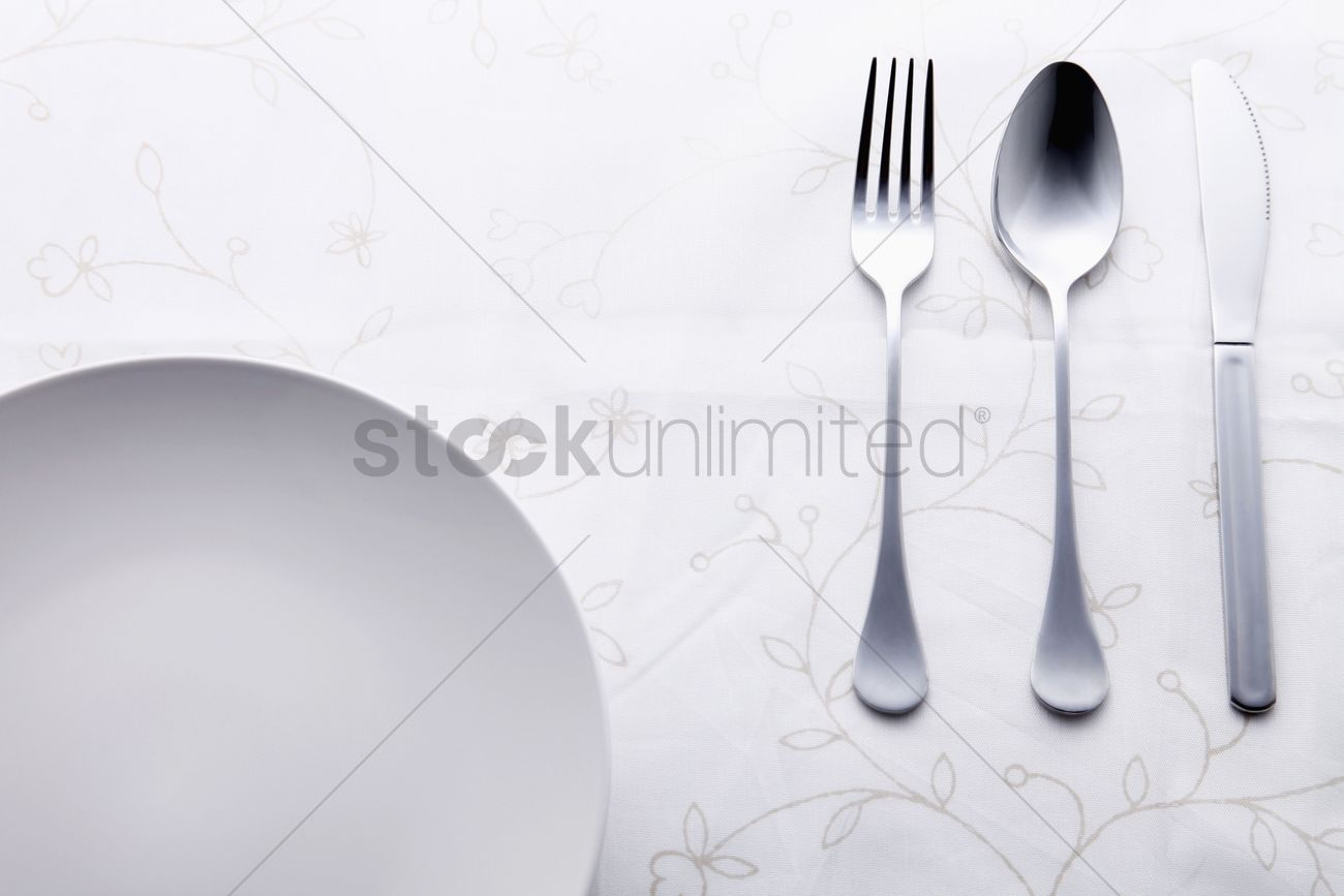 place setting of fork spoon and table knife beside plate stock photo & Place setting of fork spoon and table knife beside plate Stock ...