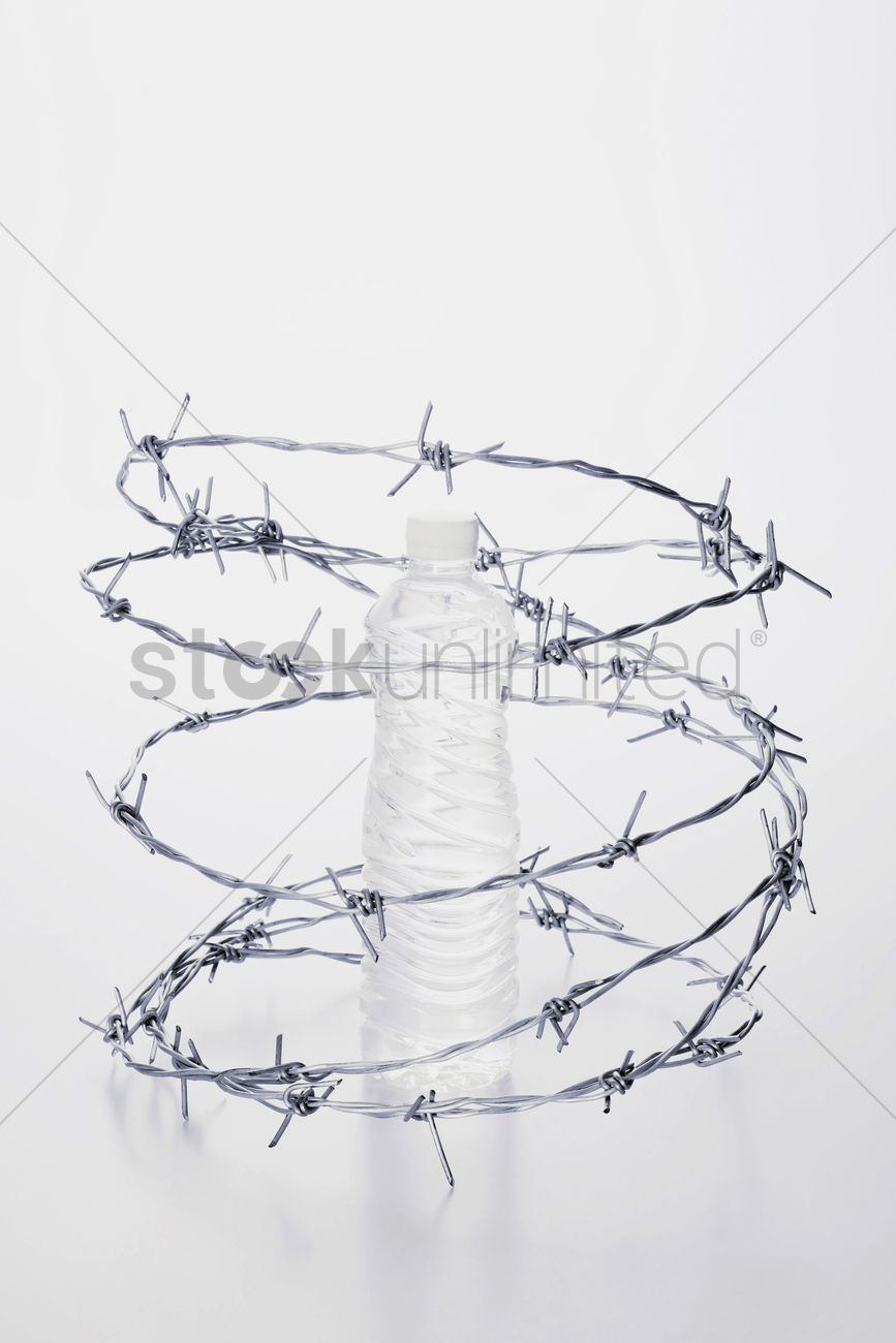 Plastic bottle surrounded by barbed wire Stock Photo - 1691941 ...