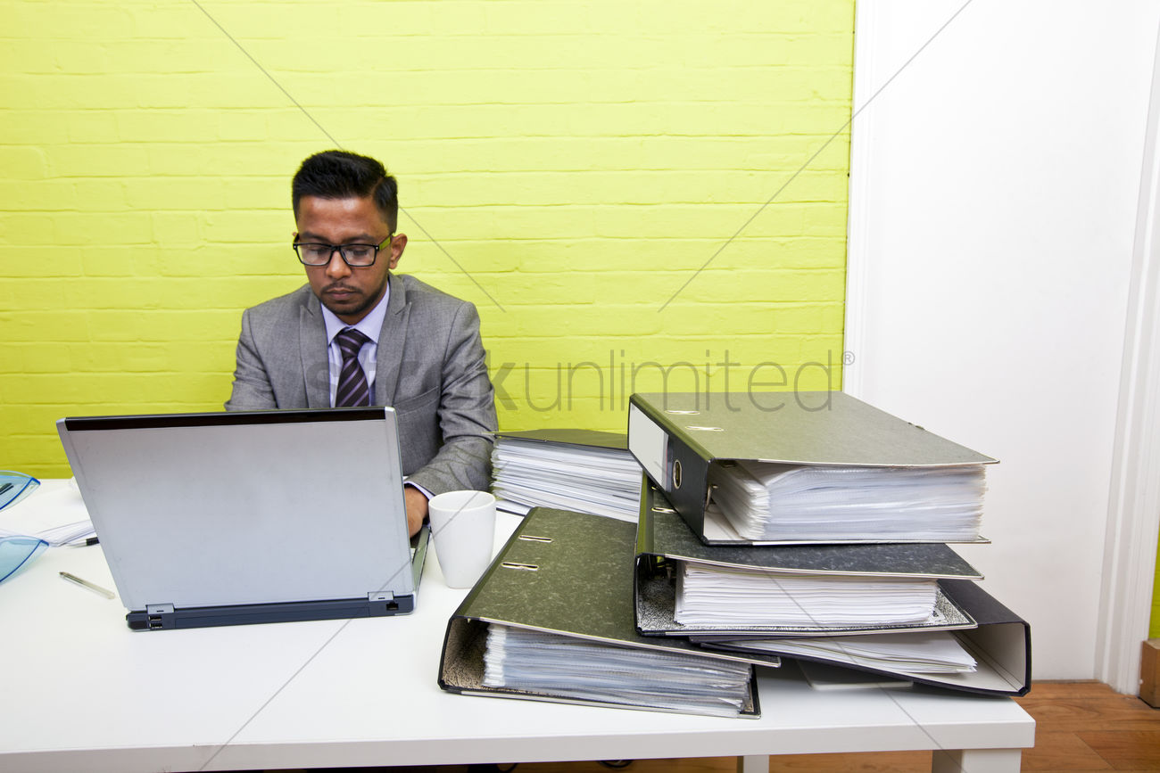 Portrait Of Indian Businessman Working On His Laptop