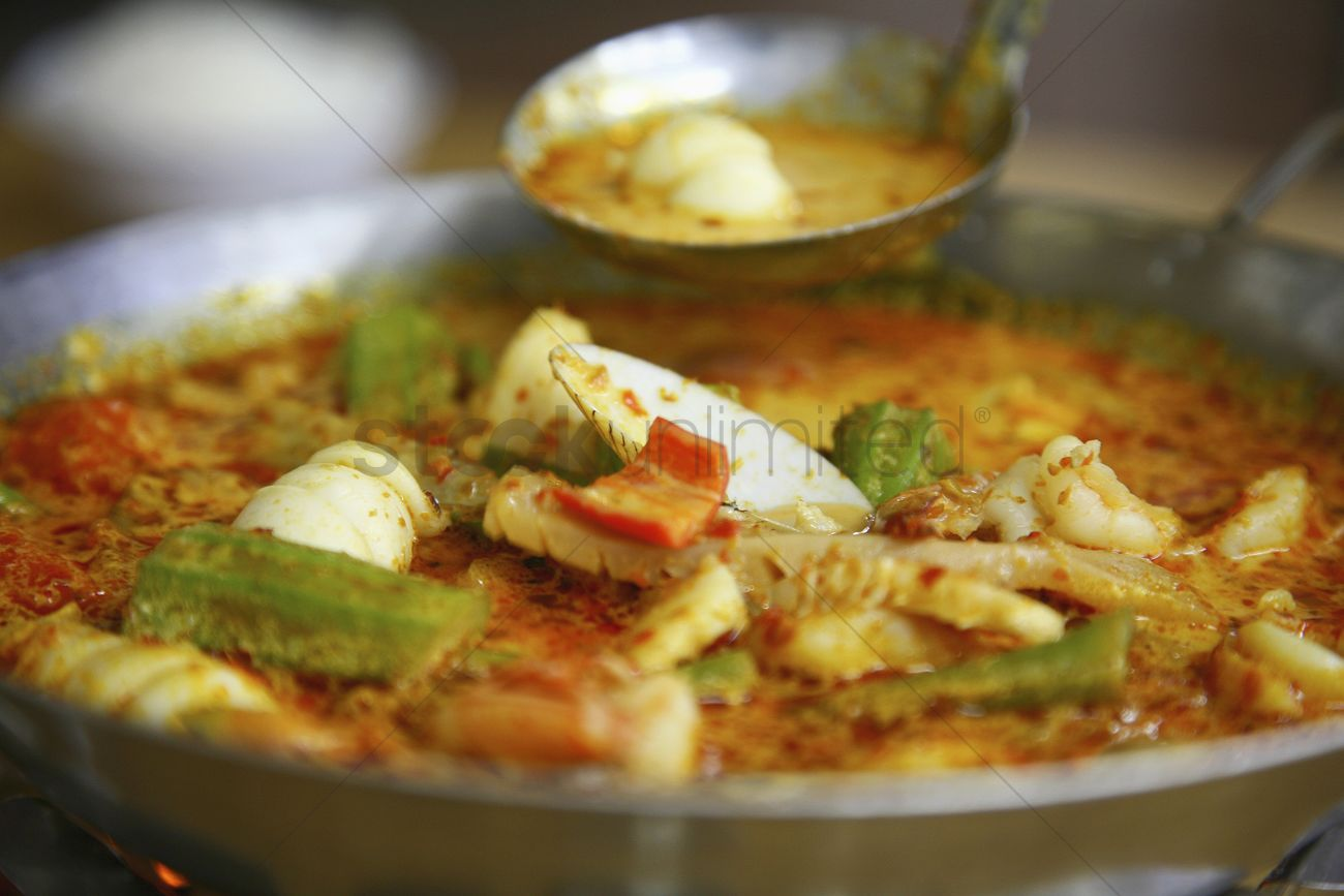 Seafood curry in wok Stock Photo ...