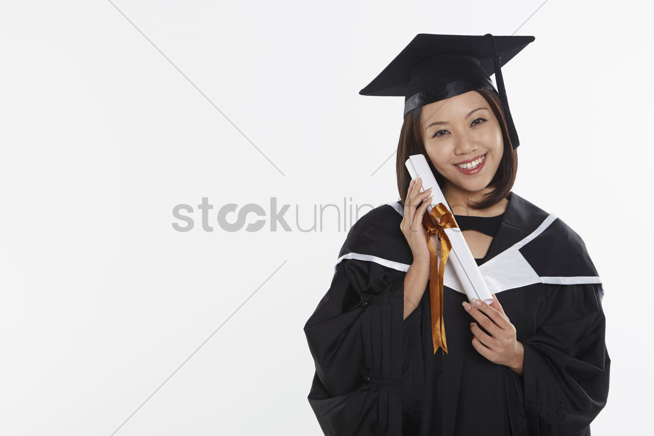 Woman in graduation gown holding a scroll Stock Photo - 1855741 ...
