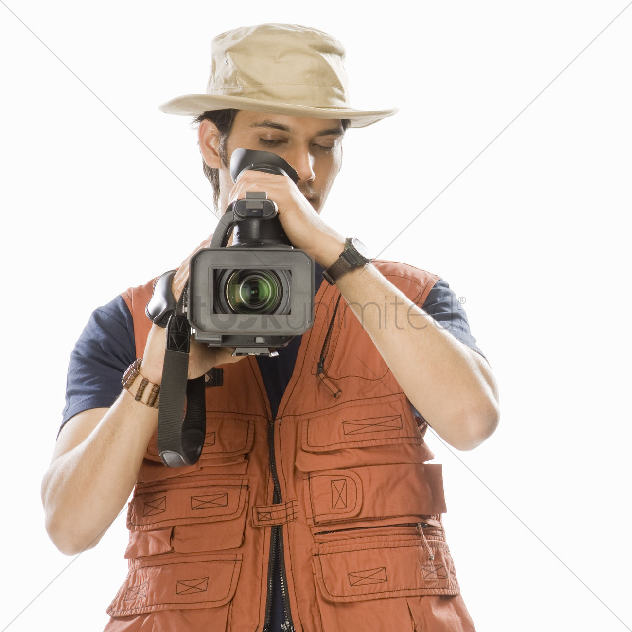 Young Male Videographer Holding A Videography Camera Stock