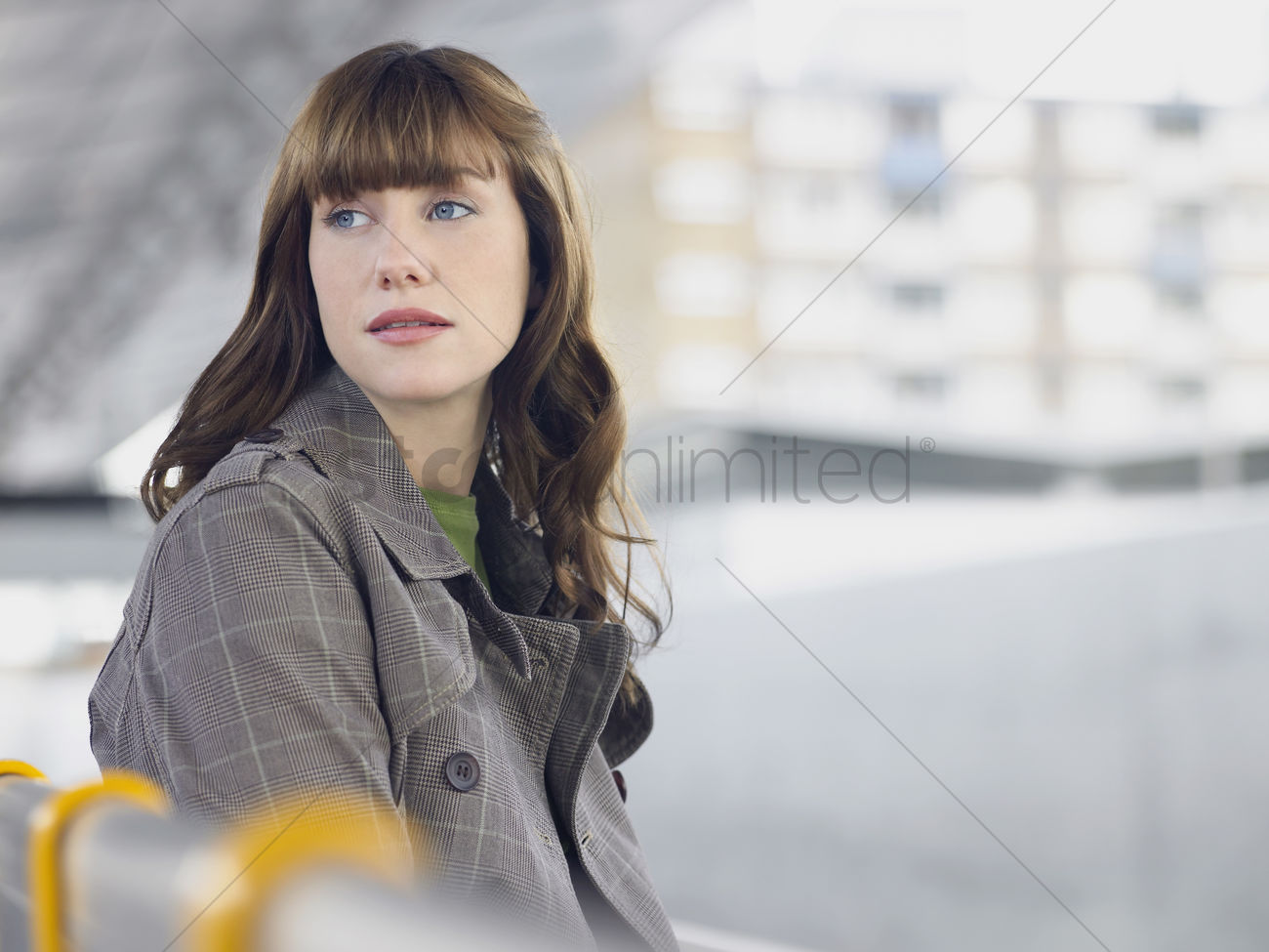 Young woman sitting looking back over shoulder Stock Photo ...
