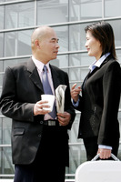A bald man talking to a woman