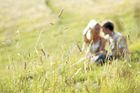 A couple sitting together on the prairie