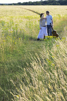 A couple walking together in the prairie