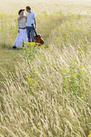 A couple walking together on the prairie