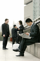 A group of working people in business suit waiting by the road side