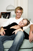 A lady lying on her boyfriend s lap on the couch