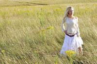 A woman standing alone on the prairie