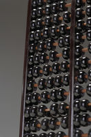 Abacus close up of rows of black beads
