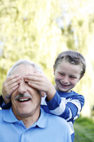 Popular : Boy covering his grandfather s eyes