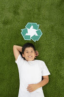 Boy lying on the grass  smiling