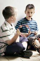 Boys playing with musical instrument