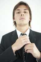 Popular : Businessman adjusting his tie
