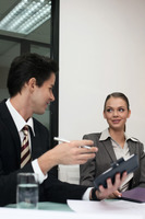Businessman and businesswoman having discussion
