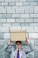 Popular : Businessman carrying a box on his head