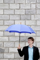 Popular : Businessman holding an umbrella