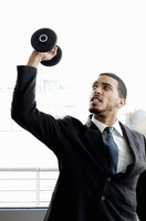 Businessman lifting dumbbell