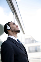 Businessman listening to music on the headphones