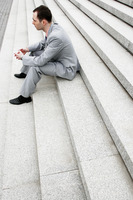 Popular : Businessman sitting on the stairs thinking