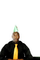 Businessman wearing a party hat