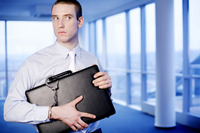 Businessman with a briefcase handcuffed to his wrist